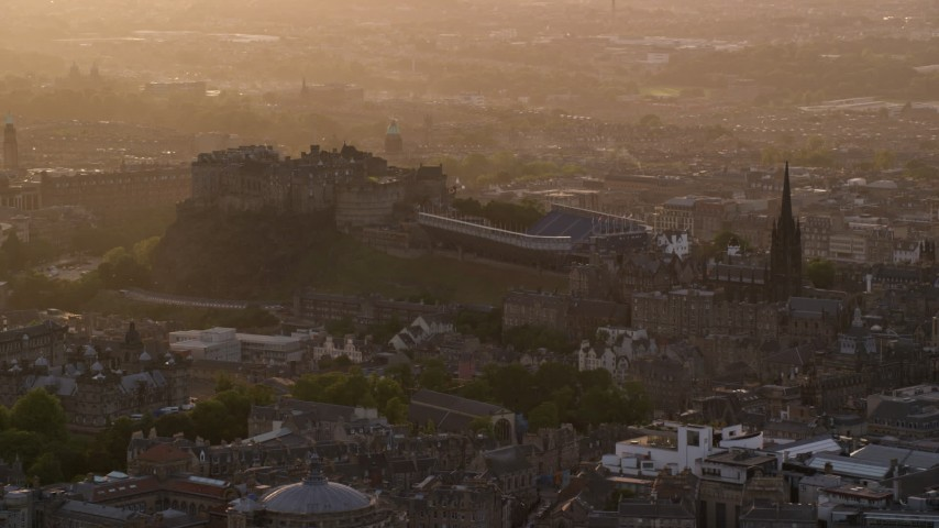 6K stock footage aerial video of The Hub and Edinburgh Castle, Scotland at sunset Aerial Stock Footage | AX112_026