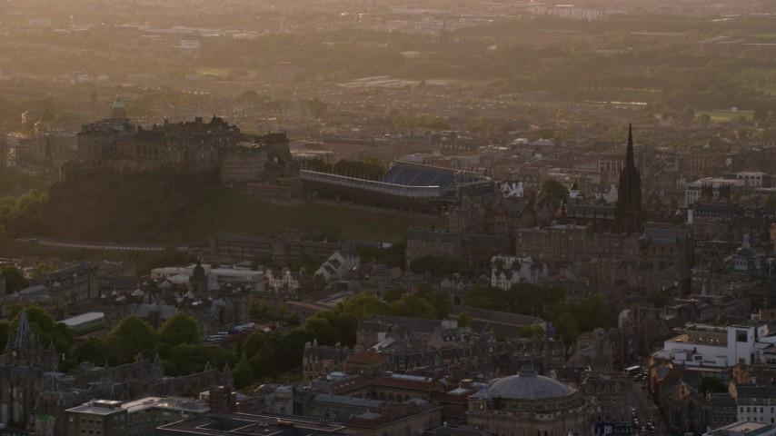 6K stock footage aerial video of slowly passing The Hub and Edinburgh Castle, Scotland at sunset Aerial Stock Footage AX112_027 | Axiom Images