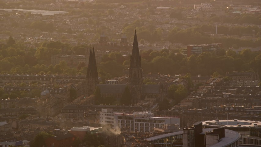 6K stock footage aerial video of flying by St Mary's Cathedral, Edinburgh, Scotland at sunset Aerial Stock Footage | AX112_029