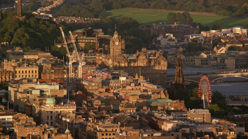 6K stock footage aerial video of Balmoral Hotel and Scott Monument, Edinburgh, Scotland at sunset Aerial Stock Footage AX112_031 | Axiom Images