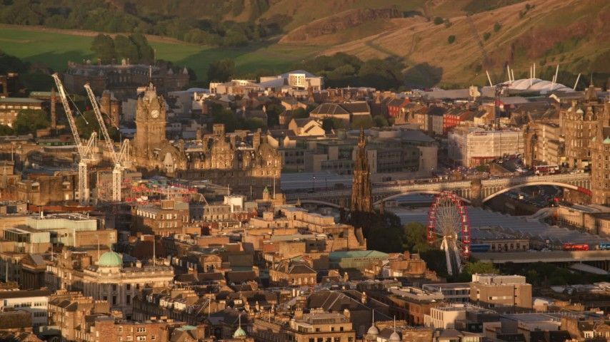 6K aerial stock footage video of Balmoral Hotel and Scott Monument in Edinburgh, Scotland at sunset Aerial Stock Footage | AX112_032
