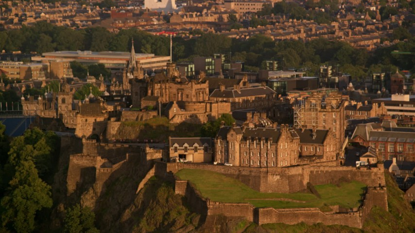 6K stock footage aerial video of passing Edinburgh Castle, Scotland at sunset Aerial Stock Footage | AX112_034