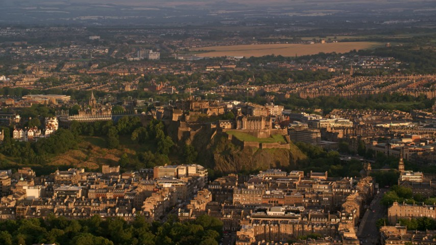 6K stock footage aerial video of Edinburgh Castle and surrounding city, Scotland at sunset Aerial Stock Footage | AX112_036