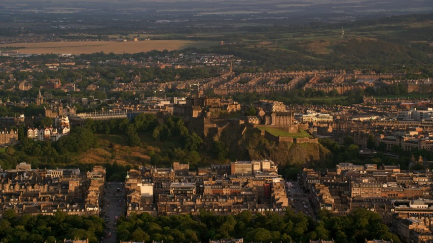 6K stock footage aerial video of a view of Edinburgh Castle and cityscape, Scotland at sunset Aerial Stock Footage | AX112_037