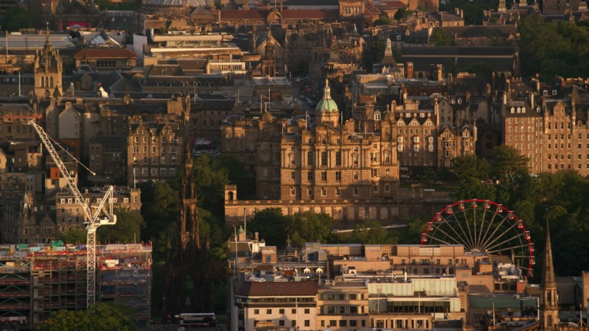 6K stock footage aerial video of Lloyds Bank Headquarters office building and ferris wheel, Scotland at sunset Aerial Stock Footage | AX112_038