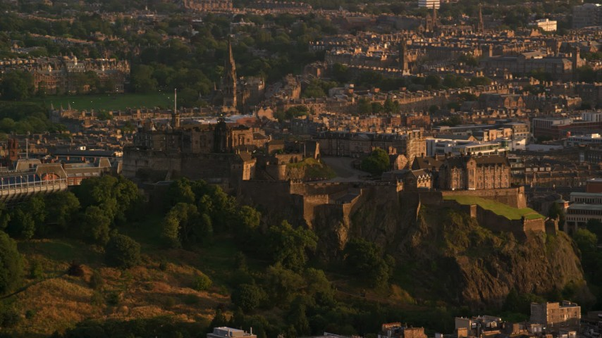 6K stock footage aerial video of Edinburgh Castle and cityscape, Scotland at sunset Aerial Stock Footage AX112_040 | Axiom Images