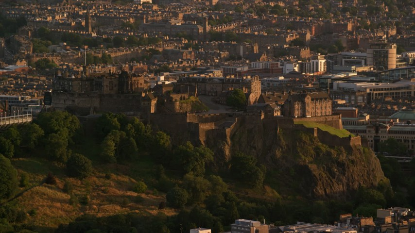 6K stock footage aerial video of a view of Edinburgh Castle in Scotland at sunset Aerial Stock Footage | AX112_041