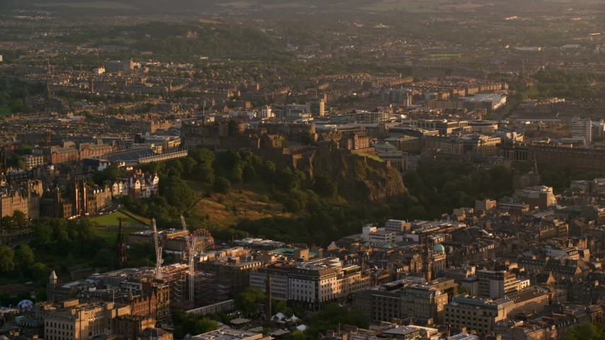 6K stock footage aerial video of Edinburgh Castle in Scotland at sunset Aerial Stock Footage | AX112_042