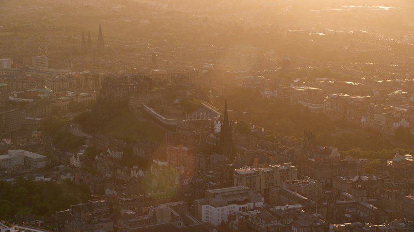 6K stock footage aerial video of Edinburgh Castle and The Hub at sunset, Scotland Aerial Stock Footage | AX112_046