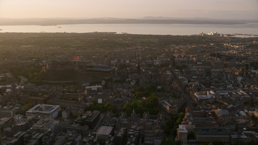 6K stock footage aerial video of Edinburgh Castle and surrounding cityscape at sunset in Scotland Aerial Stock Footage | AX112_048