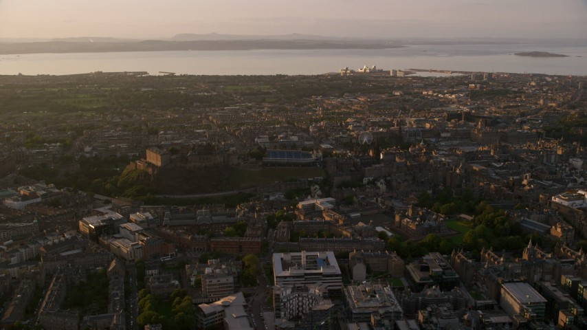 6K stock footage aerial video of flying by historic Edinburgh Castle and the cityscape, Scotland at sunset Aerial Stock Footage | AX112_049