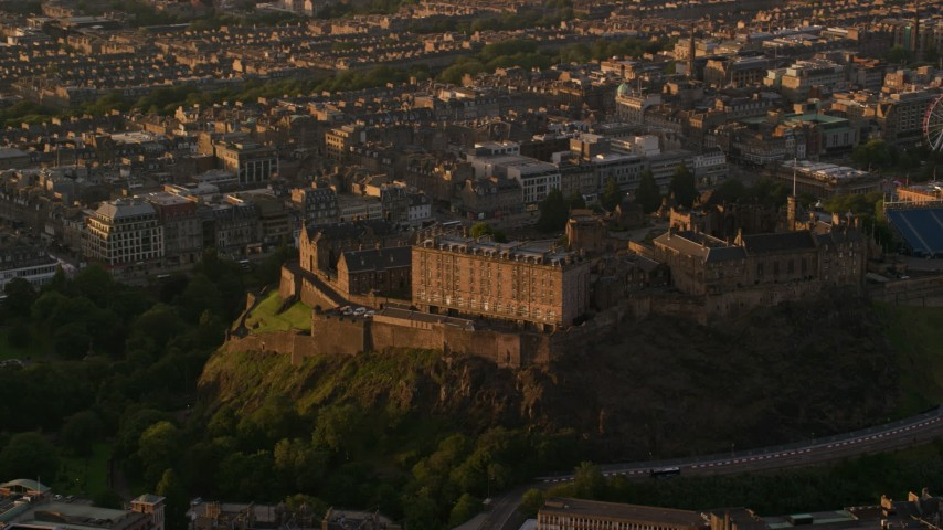 6K aerial stock footage video of orbiting Edinburgh Castle, Scotland at sunset Aerial Stock Footage | AX112_051