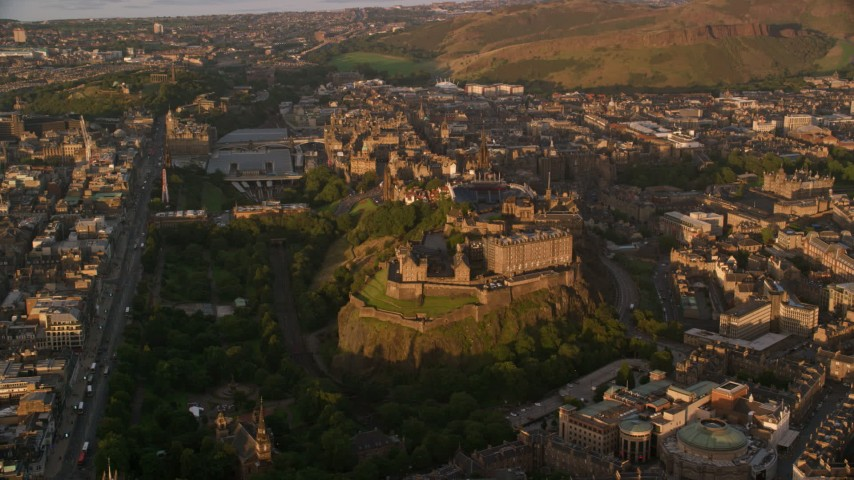 6K stock footage aerial video flyby historic Edinburgh Castle and surrounding cityscape, Scotland at sunset Aerial Stock Footage AX112_053 | Axiom Images