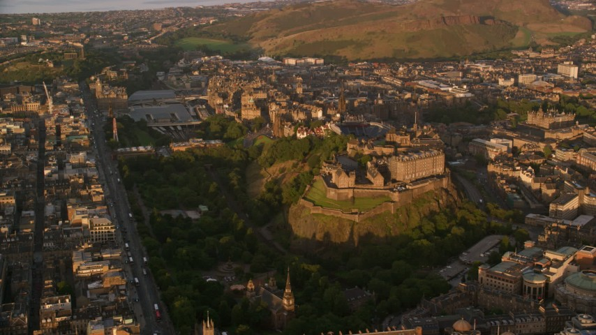 6K stock footage aerial video of historic Edinburgh Castle and cityscape, Scotland at sunset Aerial Stock Footage AX112_054 | Axiom Images