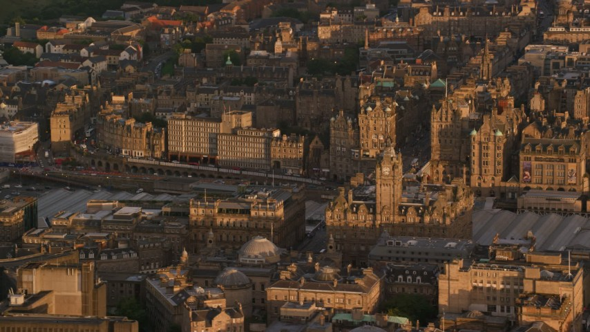 6K stock footage aerial video of Balmoral Hotel, Edinburgh, Scotland at sunset Aerial Stock Footage | AX112_057