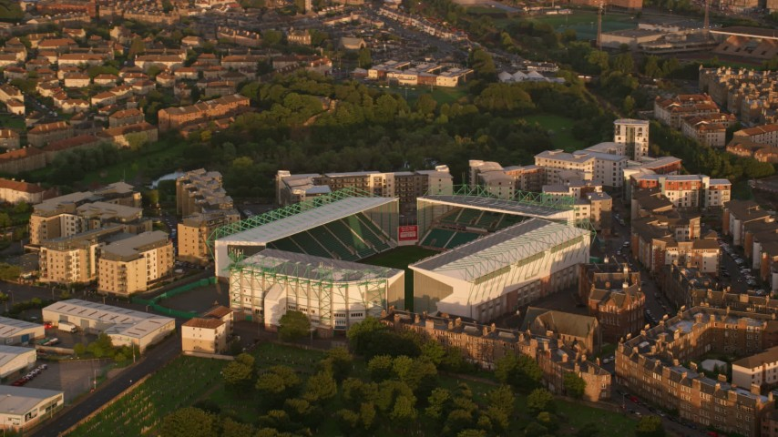 6K stock footage aerial video of Easter Road soccer stadium, Edinburgh, Scotland at sunset Aerial Stock Footage | AX112_059