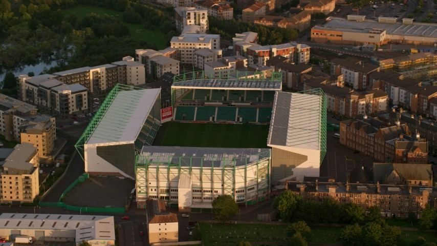 6K stock footage aerial video of orbiting Easter Road soccer stadium, Edinburgh, Scotland at sunset Aerial Stock Footage AX112_060 | Axiom Images