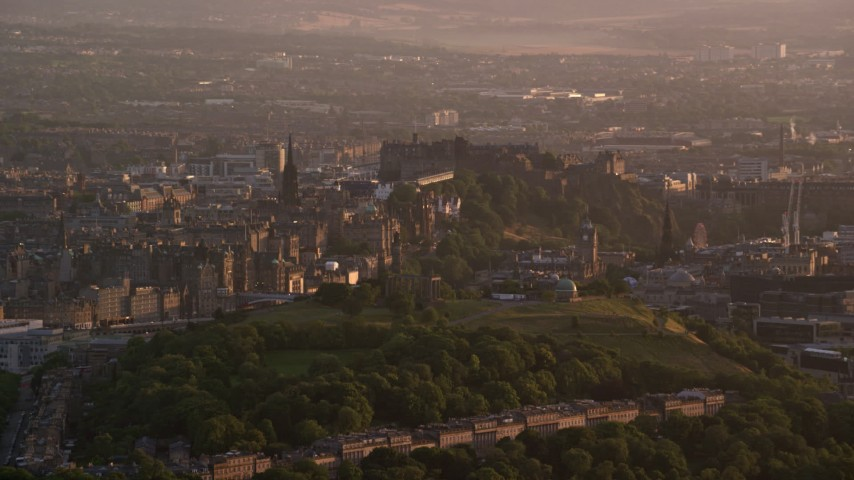 6K stock footage aerial video of Edinburgh Castle and Calton Hill, Scotland at sunset Aerial Stock Footage | AX112_062