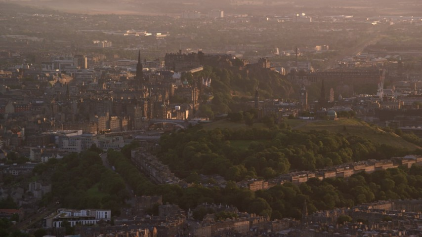 6K stock footage aerial video of a view of Edinburgh Castle and Calton Hill, Scotland at sunset Aerial Stock Footage | AX112_063