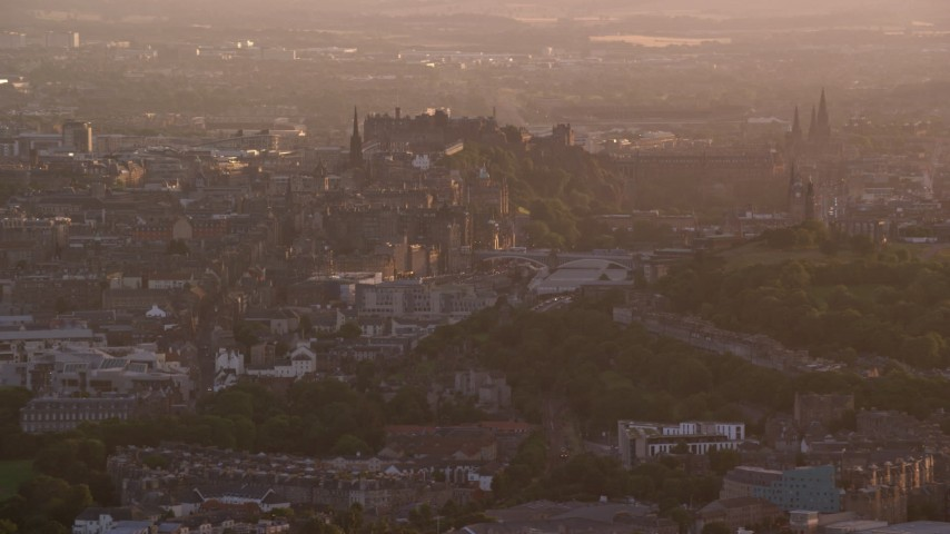 6K stock footage aerial video of passing Edinburgh Castle and cityscape, Scotland at sunset Aerial Stock Footage | AX112_064