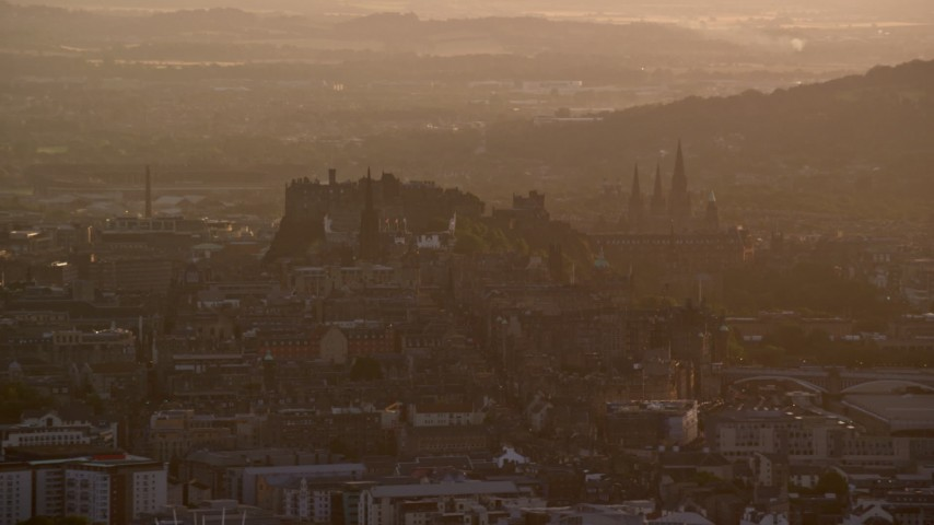 6K stock footage aerial video flyby historic Edinburgh Castle and cityscape, Scotland at sunset Aerial Stock Footage | AX112_065