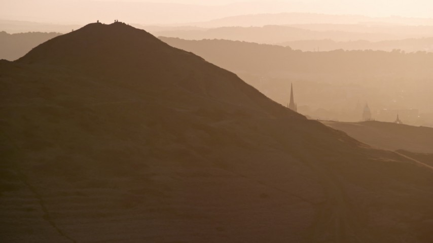6K stock footage aerial video of Arthur's Seat in Edinburgh Scotland at sunset Aerial Stock Footage | AX112_069