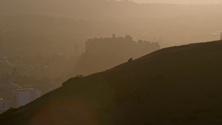 6K stock footage aerial video flyby Arthur's Seat, reveal Edinburgh Castle, Scotland at sunset Aerial Stock Footage | AX112_070
