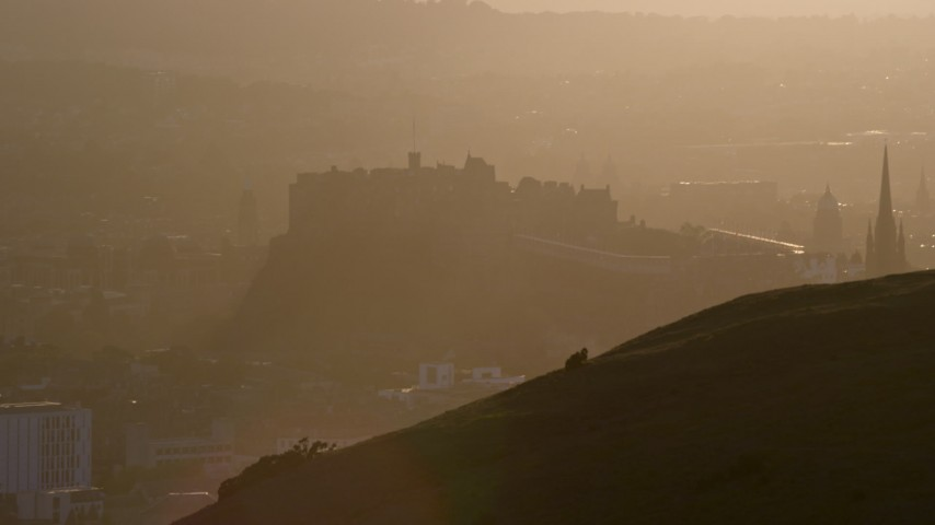 6K stock footage aerial video of Edinburgh Castle seen from Arthur's Seat, Scotland at sunset Aerial Stock Footage | AX112_071