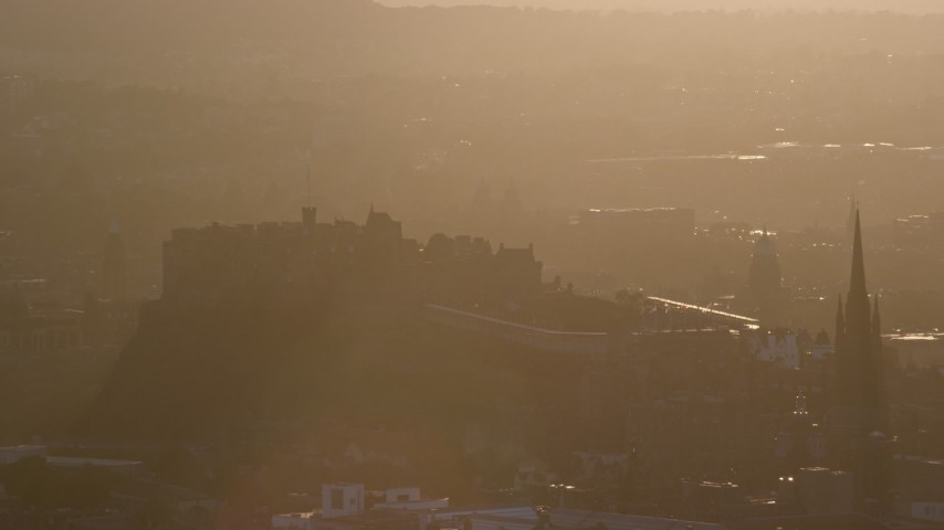 6K stock footage aerial video approach iconic Edinburgh Castle, Scotland at sunset Aerial Stock Footage | AX112_072
