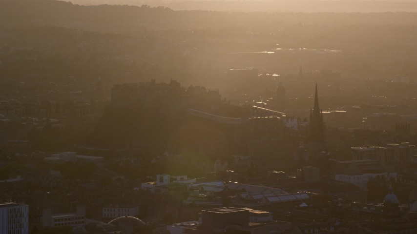 6K stock footage aerial video of historic Edinburgh Castle and The Hub cathedral, Scotland at sunset Aerial Stock Footage | AX112_073