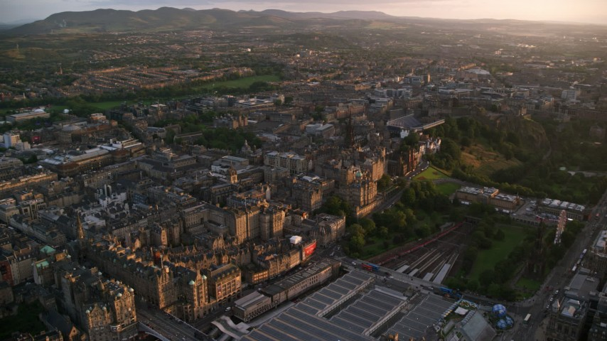 6K stock footage aerial video of a wide view of the Edinburgh cityscape, Scotland at sunset Aerial Stock Footage | AX112_077