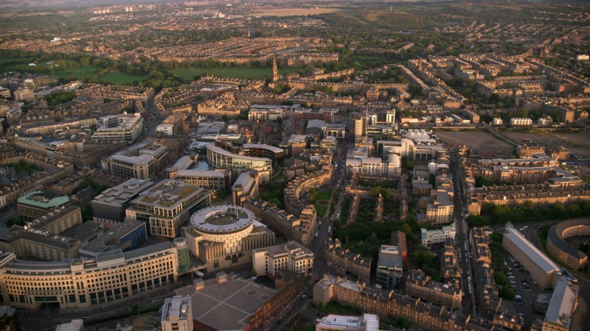 6K stock footage aerial video of panning across office buildings, Edinburgh, Scotland at sunset Aerial Stock Footage | AX112_082