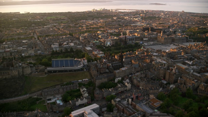 6K stock footage aerial video of flying by cityscape and Edinburgh Castle, Scotland at sunset Aerial Stock Footage | AX112_085