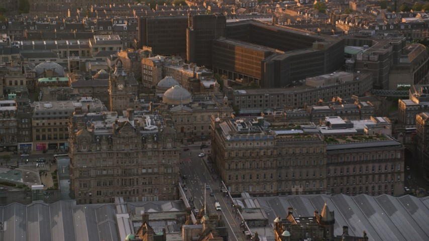 6K stock footage aerial video of the Balmoral Hotel and National Archives, Edinburgh Scotland Sunset Aerial Stock Footage | AX112_086