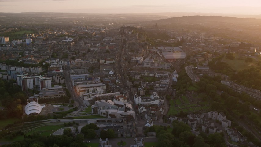 6K stock footage aerial video fly over Scottish Parliament toward Edinburgh Castle, Scotland at sunset Aerial Stock Footage | AX112_092