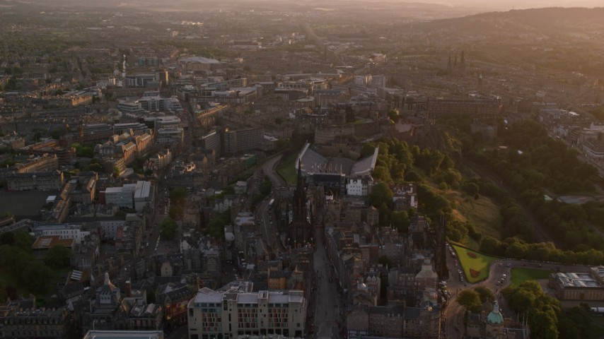 6K stock footage aerial video of an approach to iconic Edinburgh Castle, Scotland at sunset Aerial Stock Footage | AX112_096