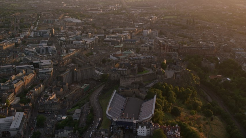 6K stock footage aerial video fly over iconic Edinburgh Castle, Scotland at sunset Aerial Stock Footage | AX112_097