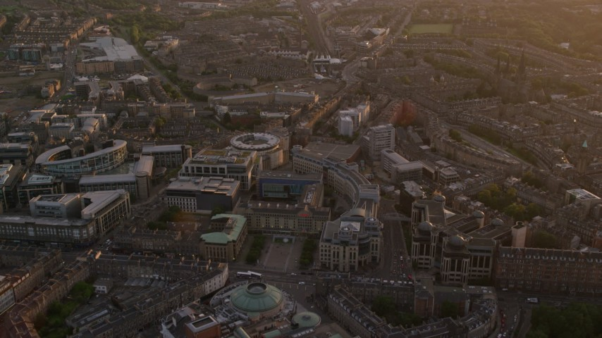 6K stock footage aerial video of flying over office buildings, Edinburgh, Scotland at sunset Aerial Stock Footage | AX112_098