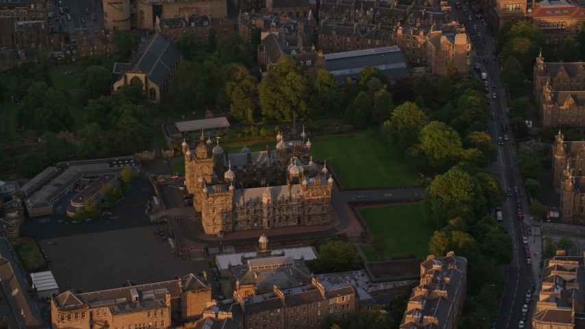 6K stock footage aerial video of orbiting a castle in Edinburgh, Scotland at sunset Aerial Stock Footage | AX112_099
