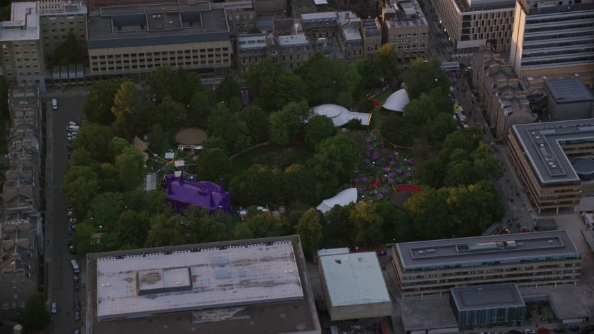 6K stock footage aerial video of circling George Square Gardens with trees, University of Edinburgh, Scotland at sunset Aerial Stock Footage | AX112_102