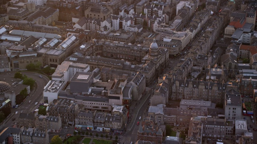 6K stock footage aerial video of orbiting University of Edinburgh, Scotland at sunset Aerial Stock Footage | AX112_104