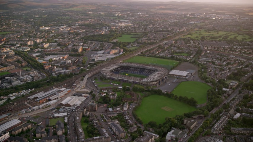 6K stock footage aerial video of approaching Murrayfield Stadium, Edinburgh, Scotland at Sunset Aerial Stock Footage | AX112_109