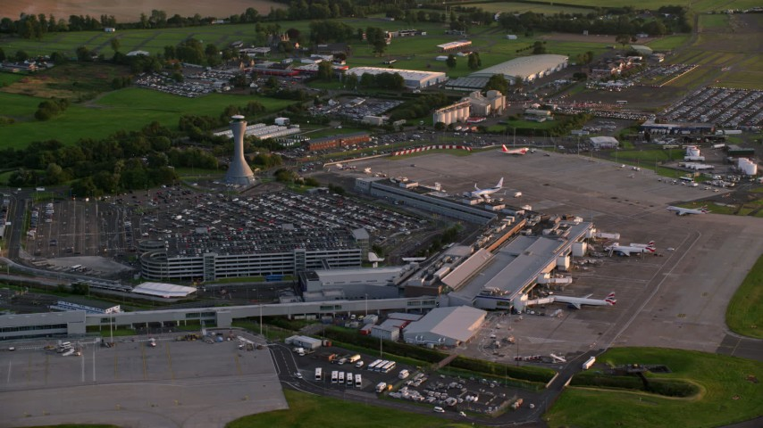 6K stock footage aerial video of terminals and control tower of Edinburgh Airport, Scotland at sunset Aerial Stock Footage | AX112_118