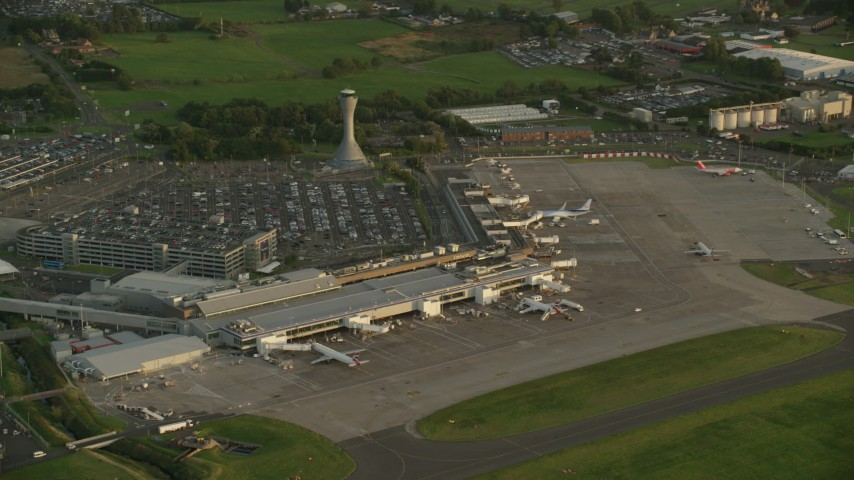 6K stock footage aerial video of orbiting Edinburgh Airport, Scotland at sunset Aerial Stock Footage | AX112_119