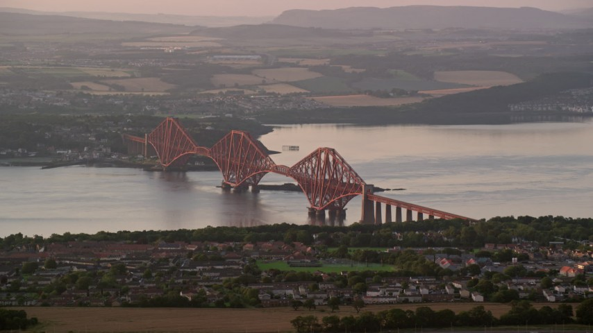 6K stock footage aerial video of Forth Bridge on Firth of Forth, Edinburgh, Scotland at sunset Aerial Stock Footage | AX112_120