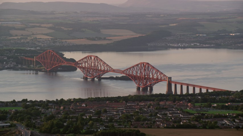 6K stock footage aerial video of Forth Bridge spanning Firth of Forth, Edinburgh, Scotland at sunset Aerial Stock Footage | AX112_121