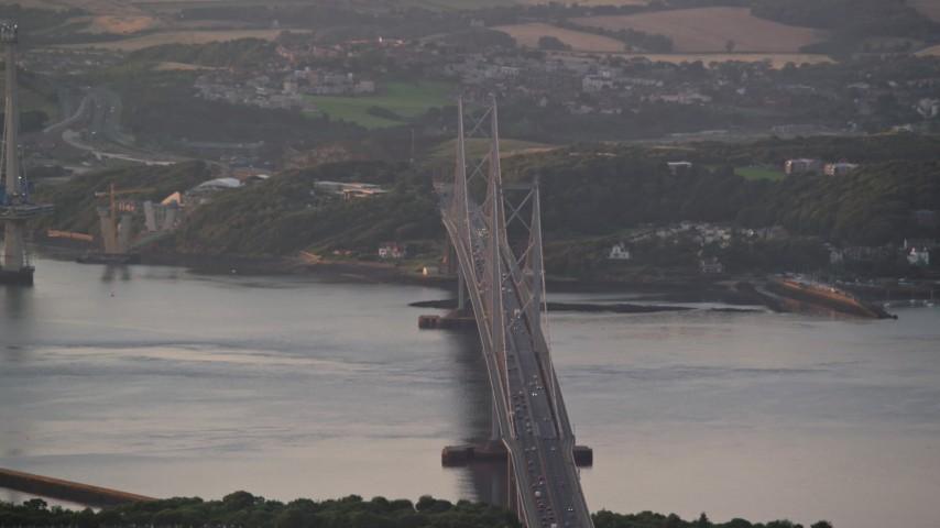 6K stock footage aerial video of the Forth Road Bridge, Edinburgh, Scotland at sunset Aerial Stock Footage | AX112_122