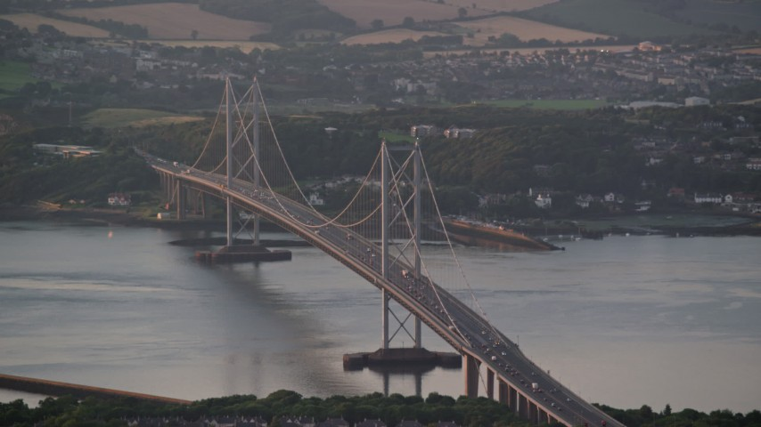 6K stock footage aerial video of the Forth Road Bridge over the Firth of Forth, Edinburgh, Scotland at sunset Aerial Stock Footage | AX112_123