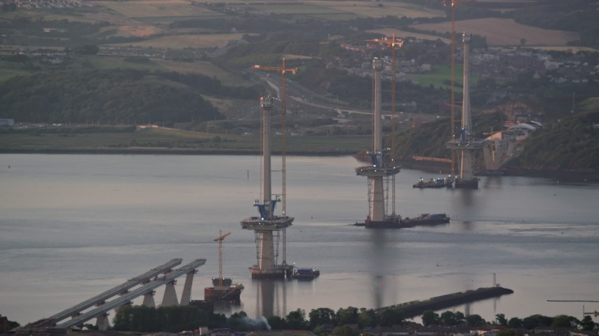 6K stock footage aerial video of bridge construction over the Firth of Forth, Edinburgh, Scotland at sunset Aerial Stock Footage | AX112_124