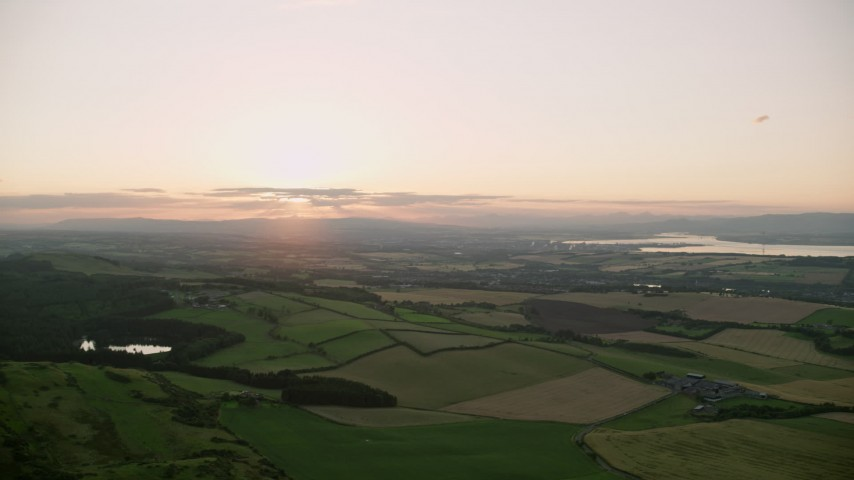 6K aerial video of panning across farming fields in Linlithgow, Scotland Aerial Stock Footage | AX112_133